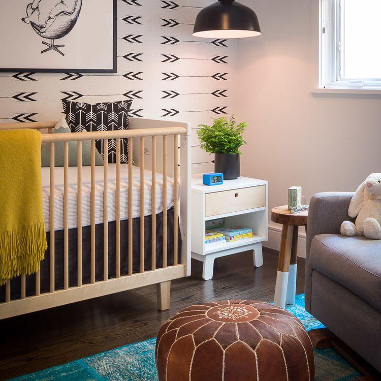 Modern midcentury-inspired nursery with tribal theme