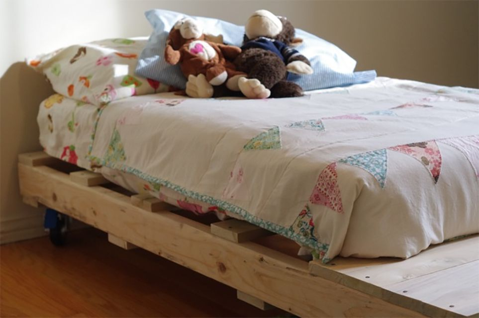 A toddler bed made of pallets