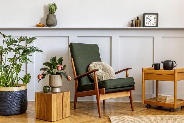 A green armchair in an eclectic living room