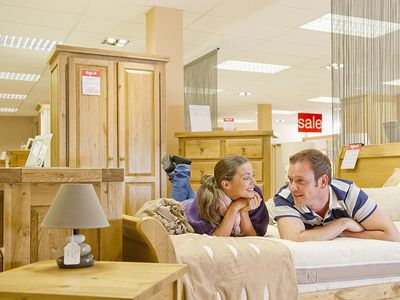 Couple shopping for furniture in store