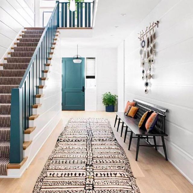 staircase with a teal banister