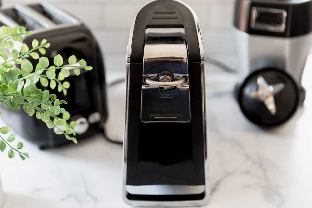Black can opener, toaster and blender next to houseplant to sell for cash