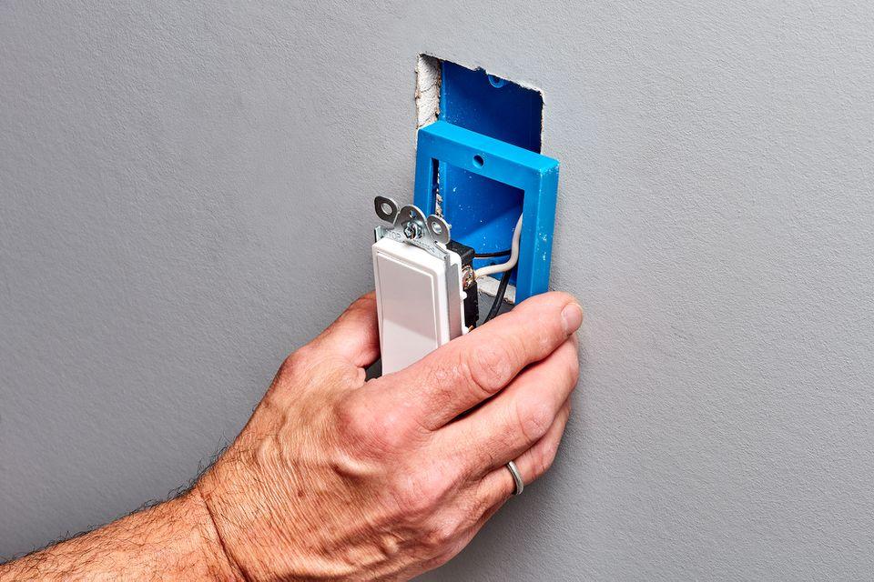 Electrical box adding an extender behind a light switch