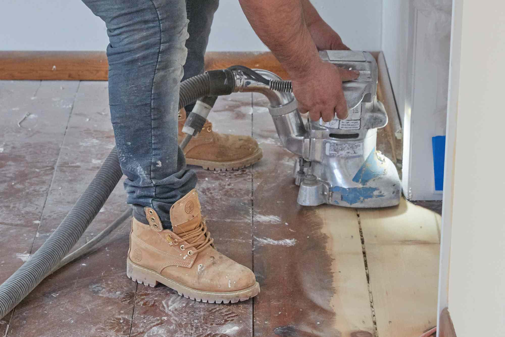Edge floor sander hand-held over hardwood floor