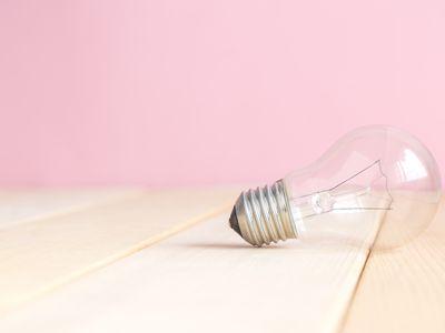 Light bulb on table studio shoot. Space for copy.
