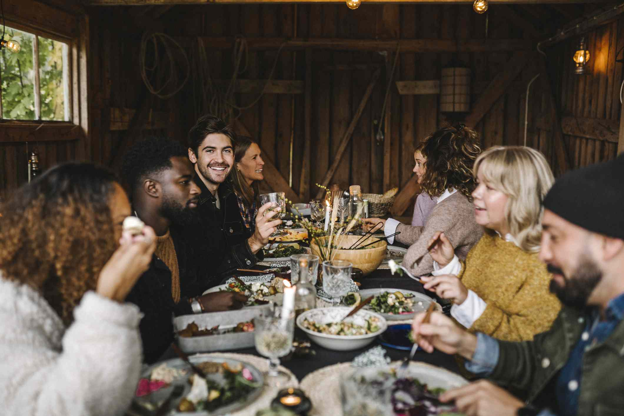 A group of people enjoying a rustic meal