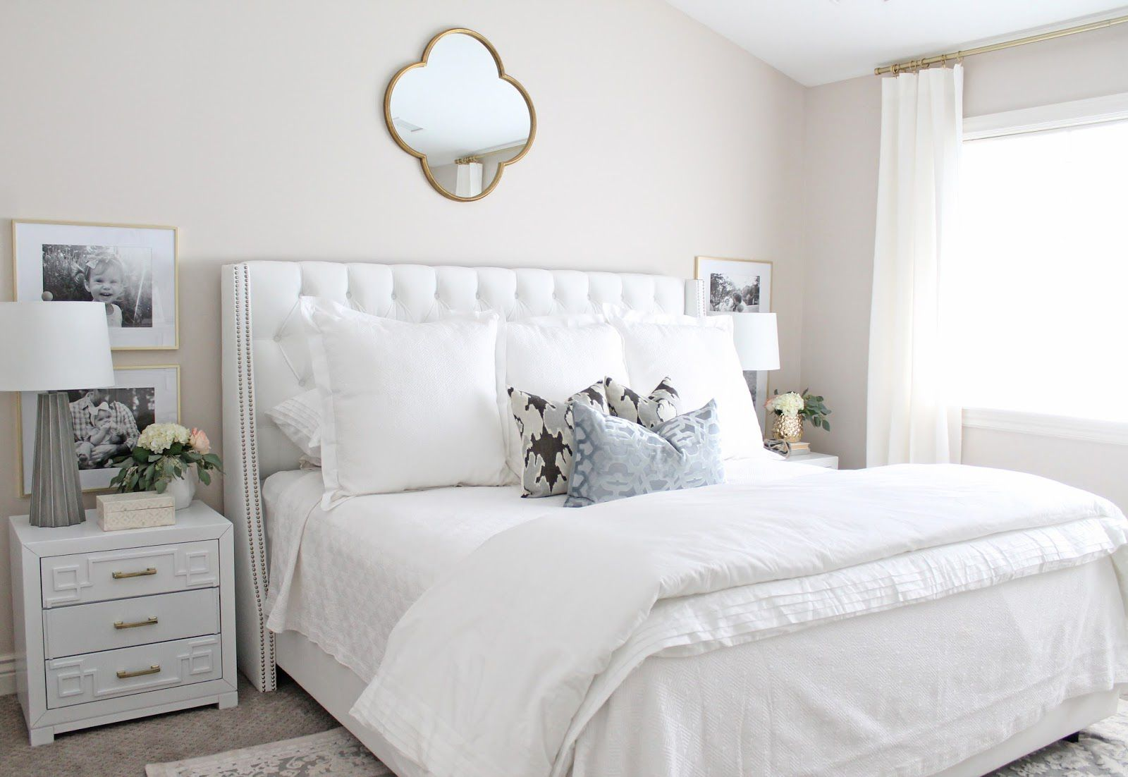 brass mirror over bed