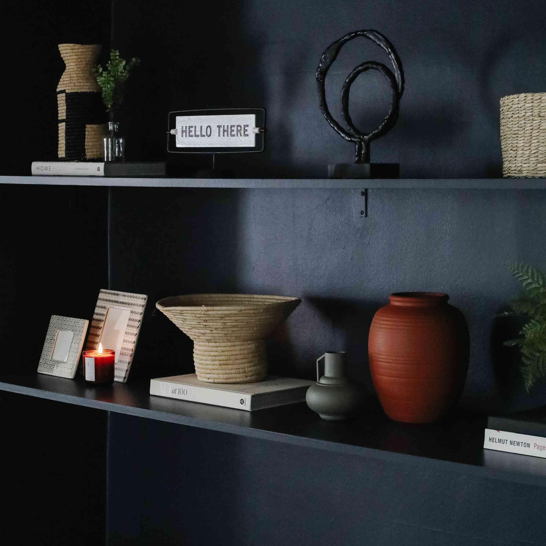 black shelves are part of the decor of drew scott's apartment