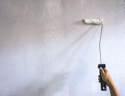Rolling Paint Primer on a Wall