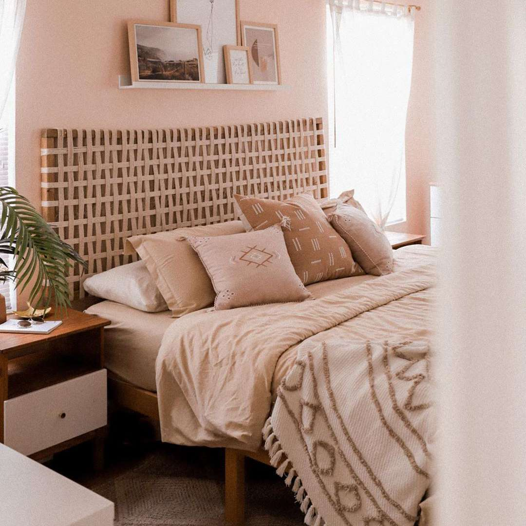 Bedroom with light pink wall