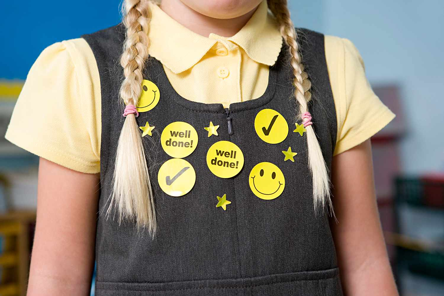 Stickers on a girls pinafore