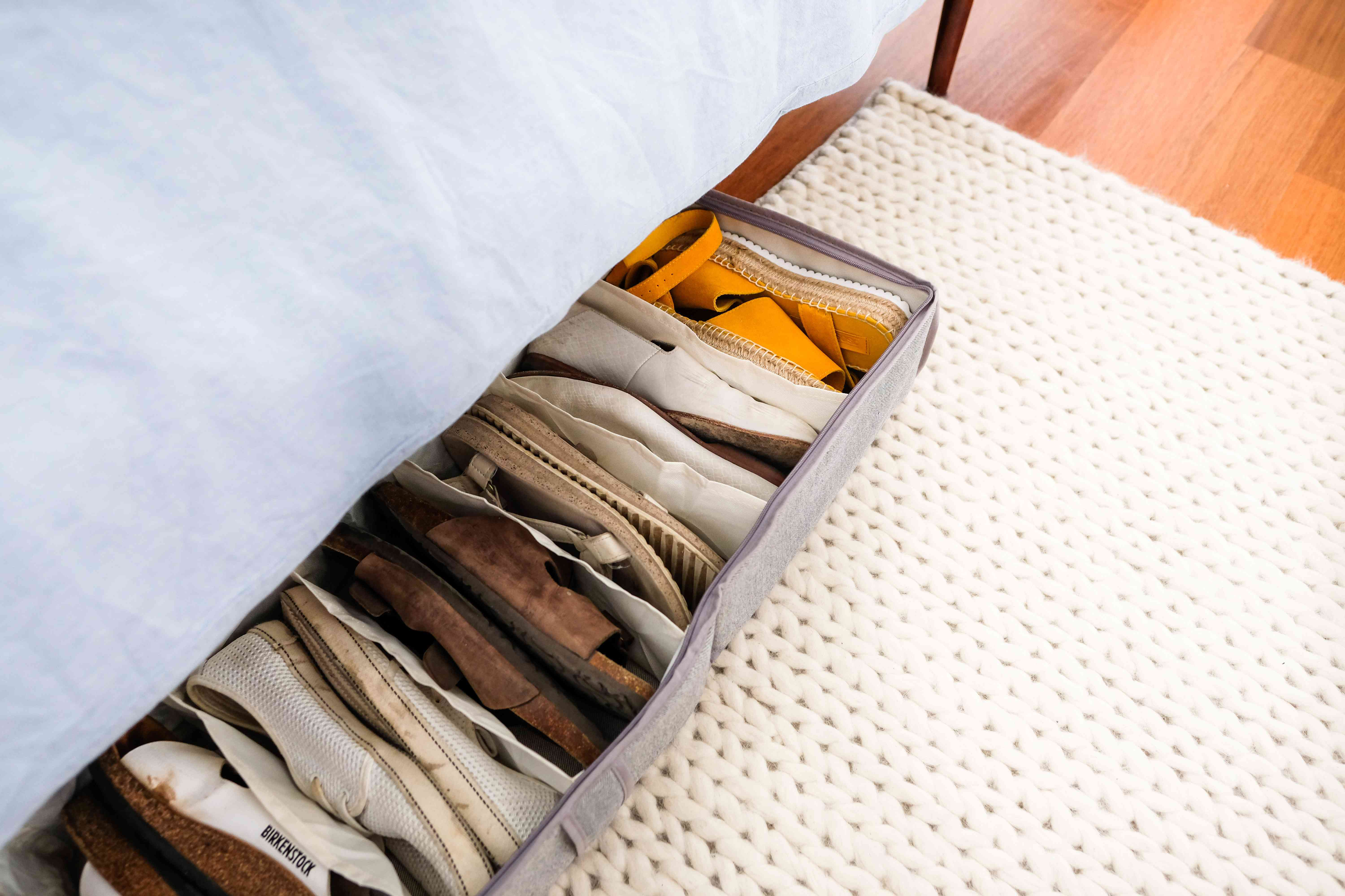 Storing shoes under the bed in a bin