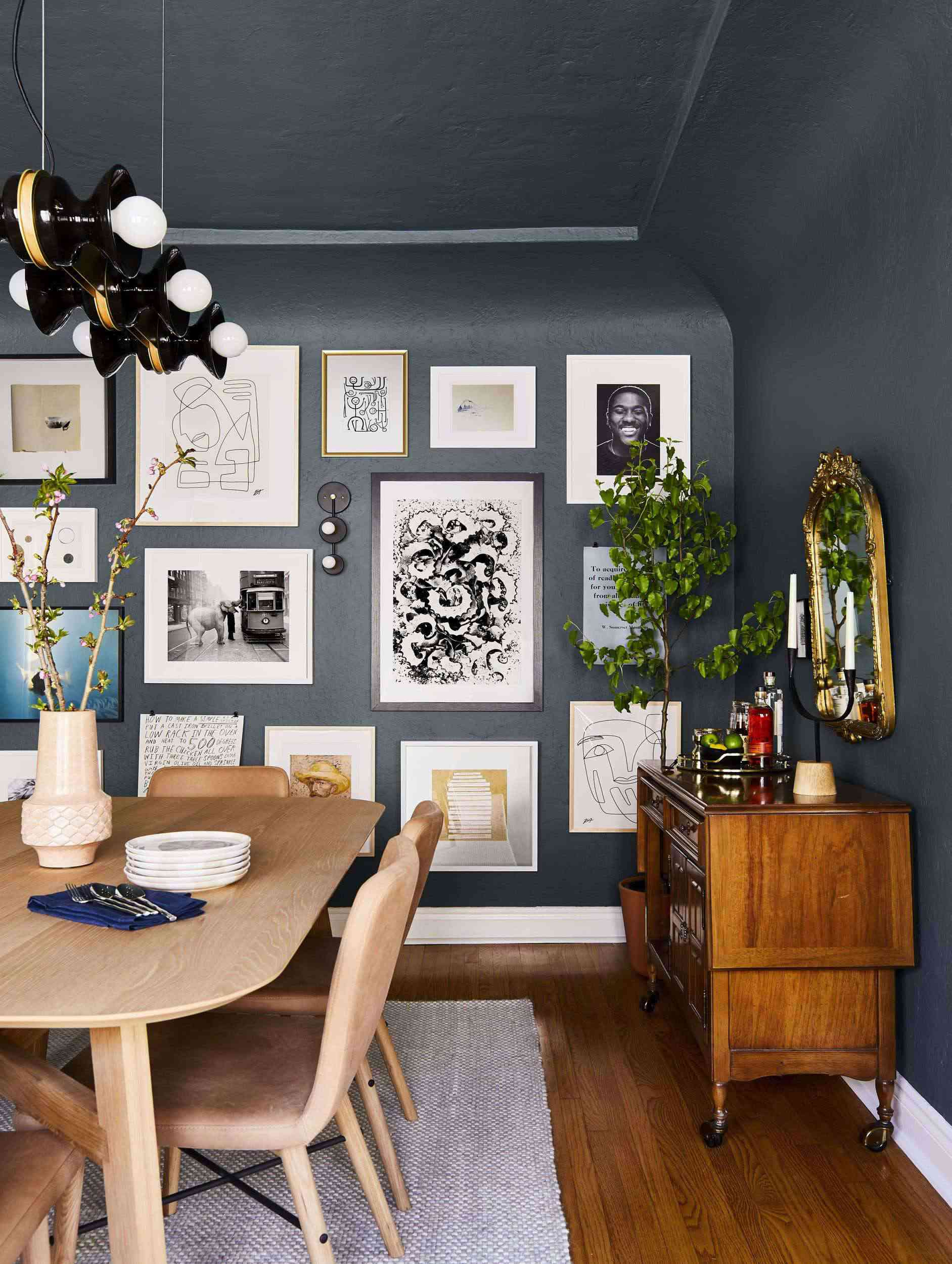 moody blue walls, gallery wall in dining room