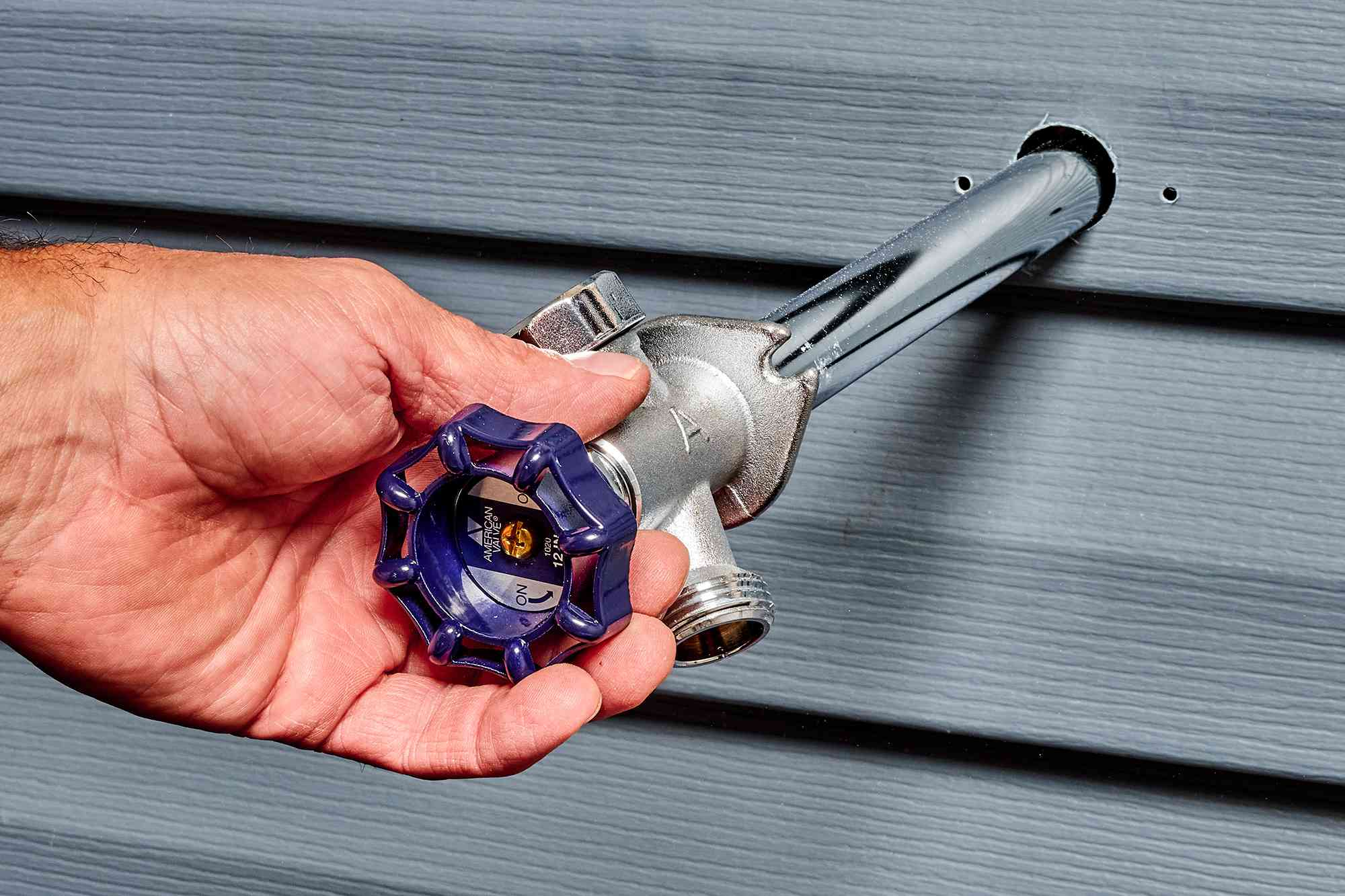New frost-free faucet inserted into exterior wall