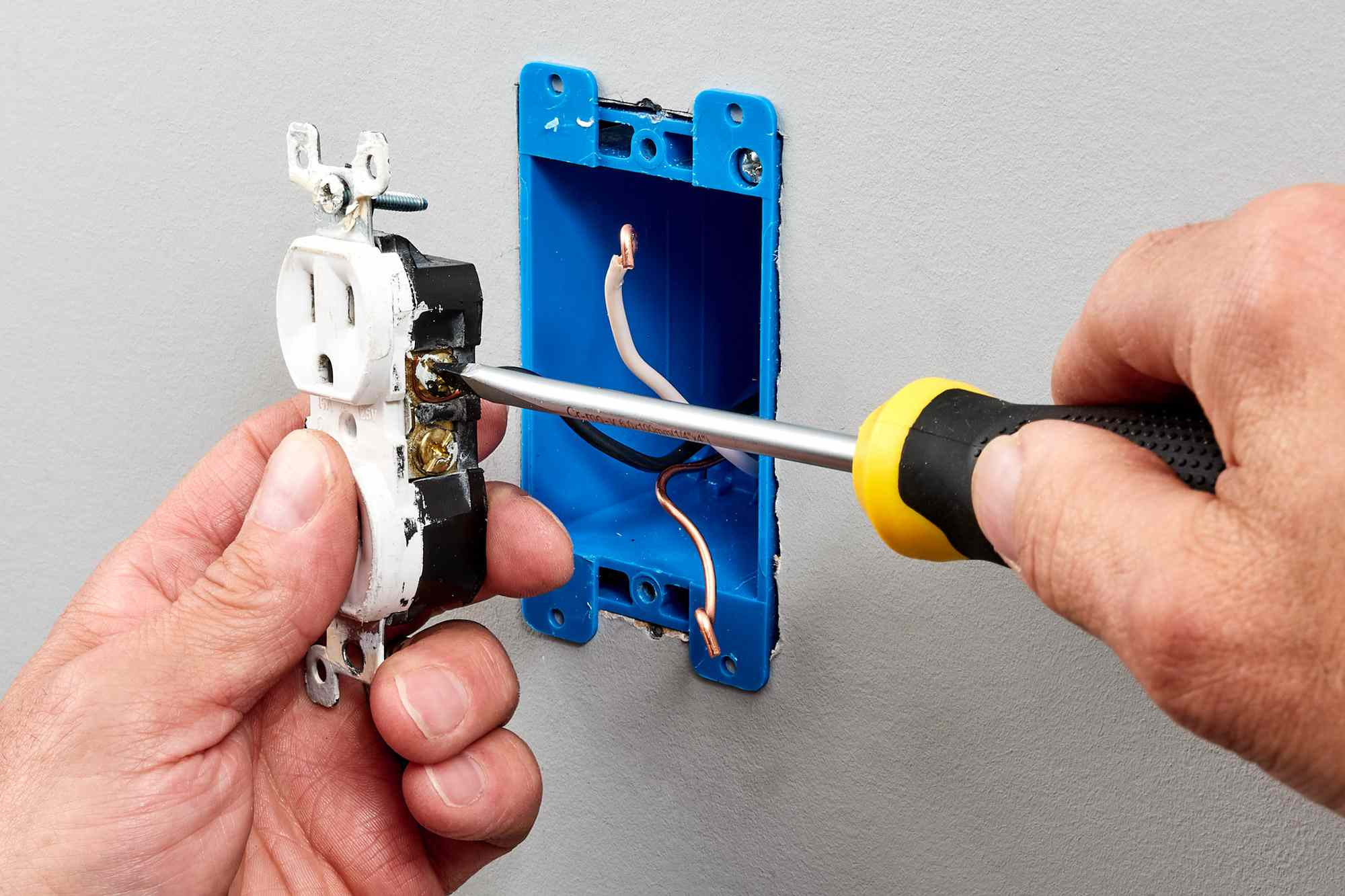Screw terminals loosened on receptacle for removal