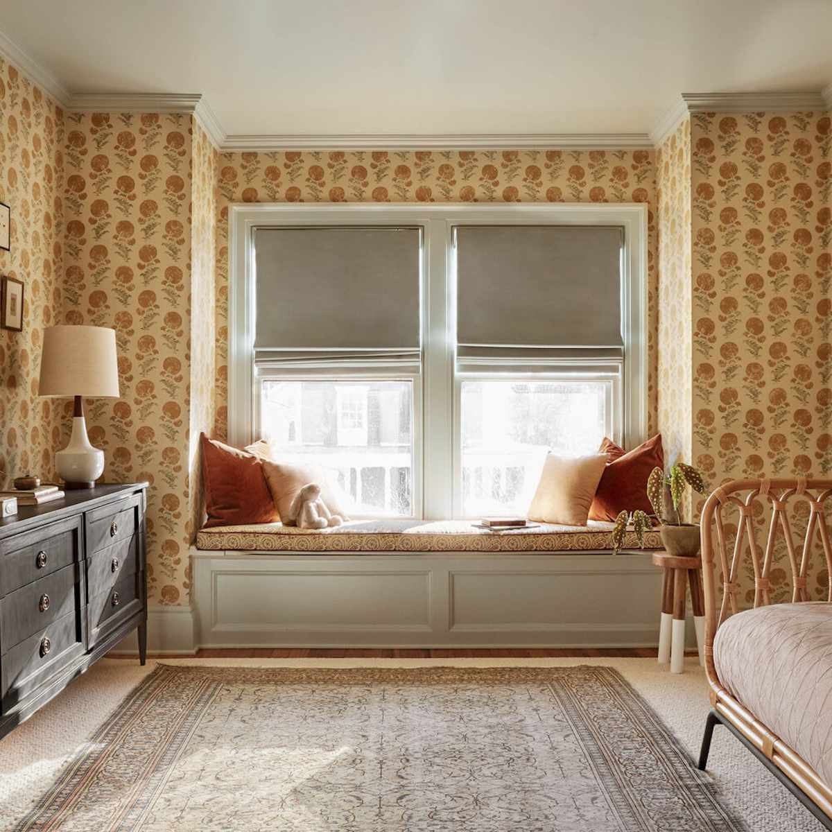 traditional, vintage style bedroom with yellow floral walls, wicker and wood furniture