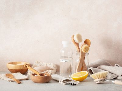 A collection of cleaning products and wood accessories