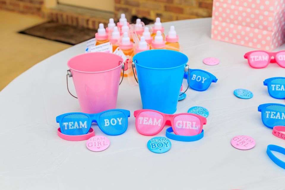 Team boy and team girl items at a gender reveal party