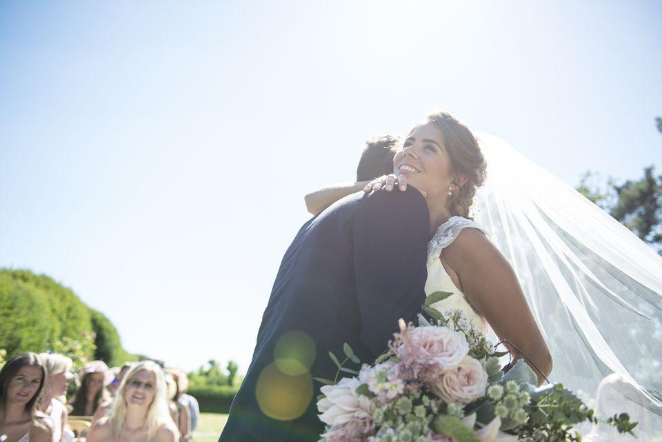 Bride and groom hugging during ceremony