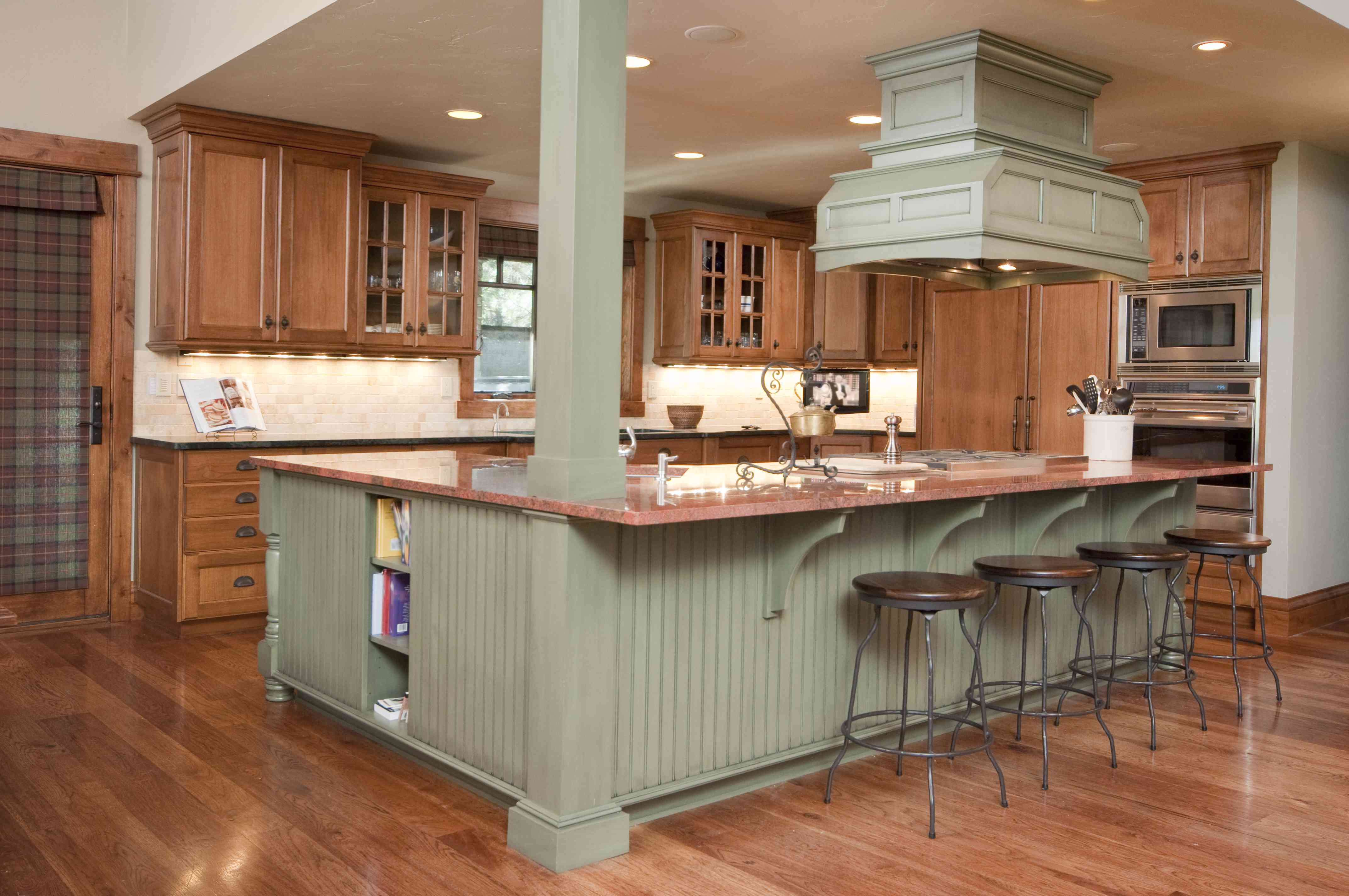 A modern kitchen with an island seating area