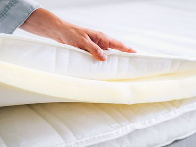Foam mattress pad removed from bed topper for cleaning