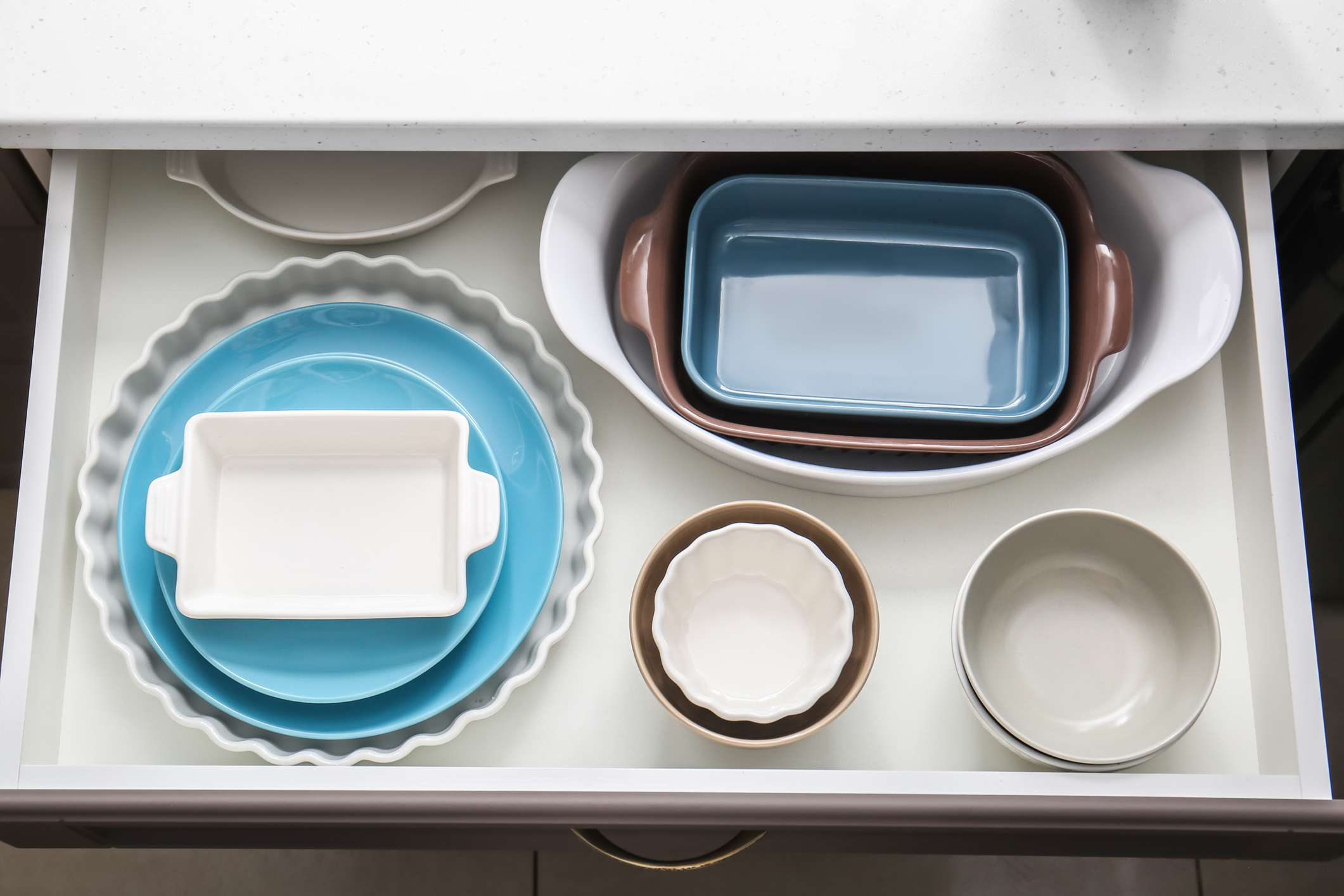 casserole dishes in a rawer