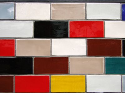 Colourful glazed rectangular ceramic tiles on the exterior wall of a building
