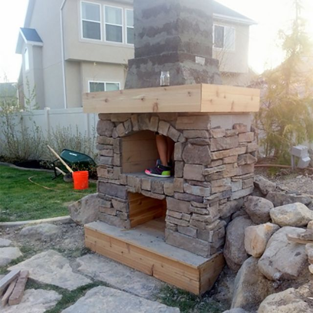 A stone fireplace being built