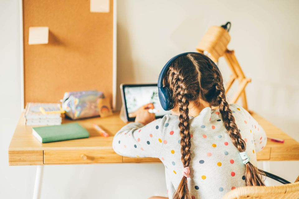 Young girl virtually learning at home