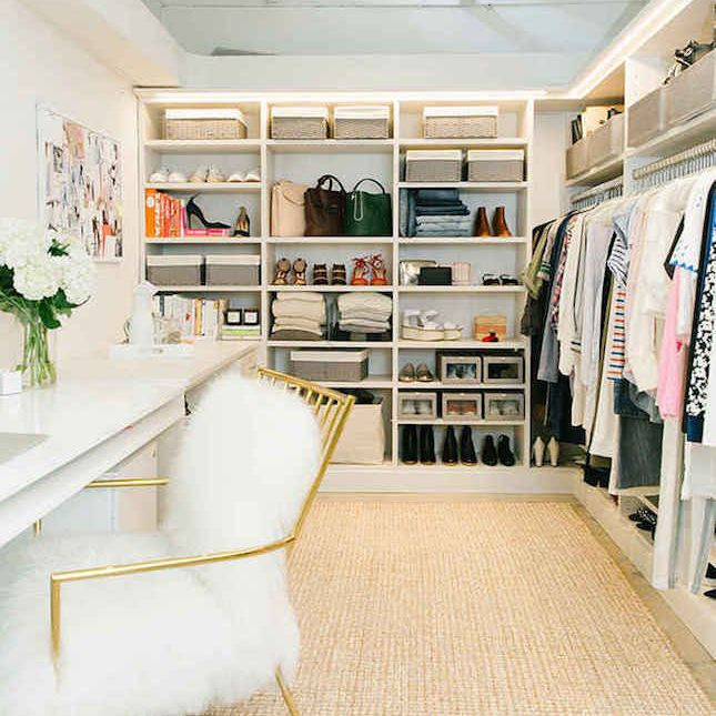 Large walk-in closet with a fuzzy chair