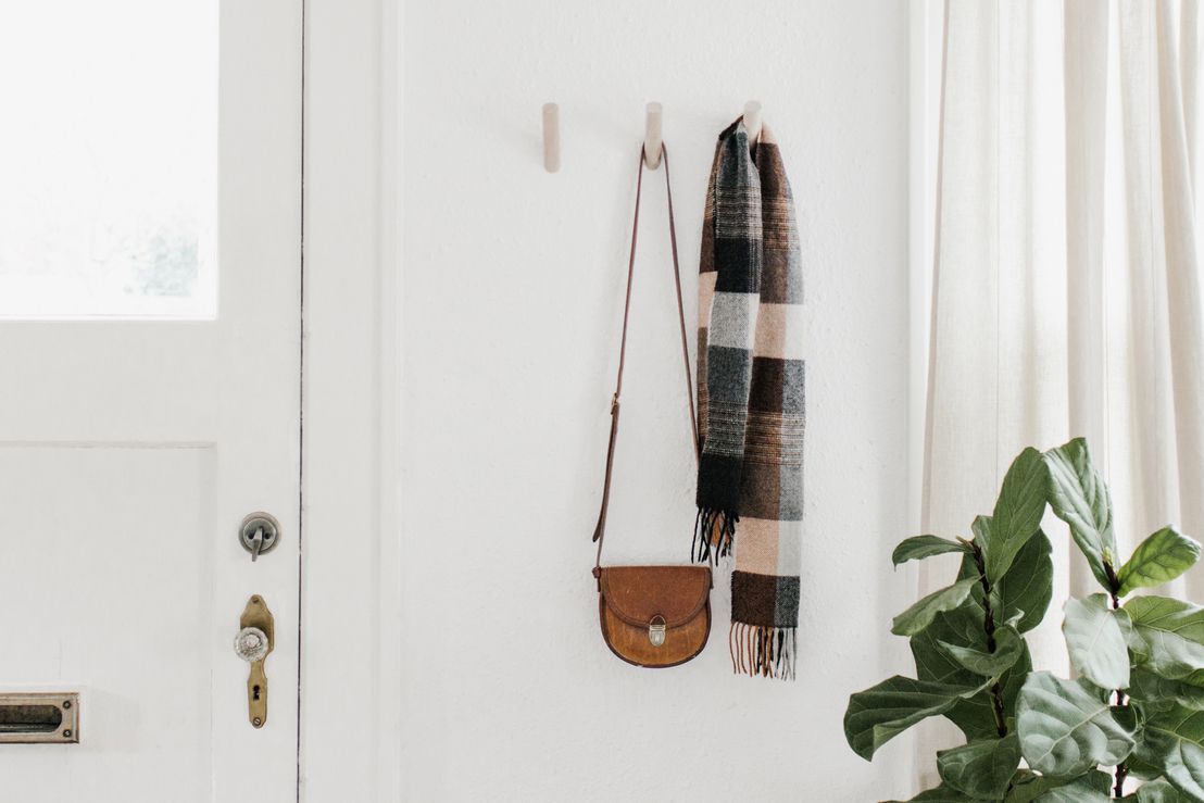 scarf and bag on coat hooks