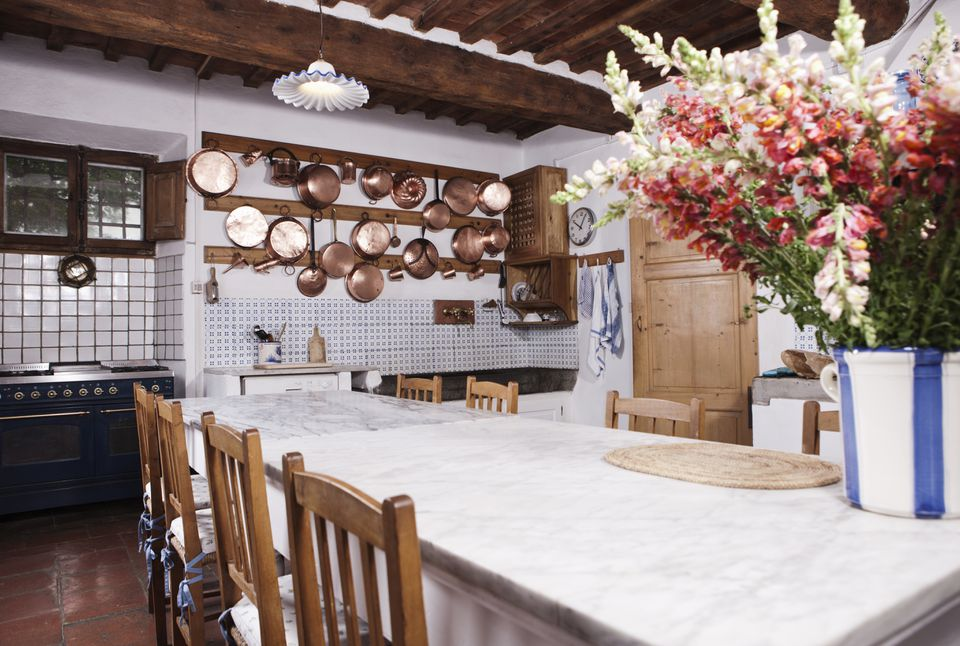 Italy, Tuscany, Magliano, View of kitchen with flowers on dining table