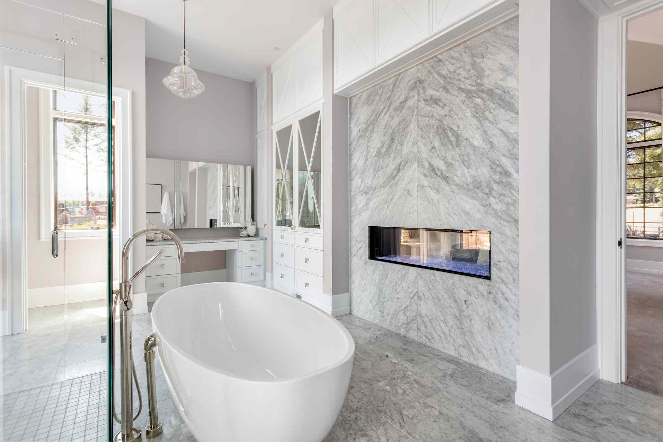 Double-sided fireplace in a master bathroom