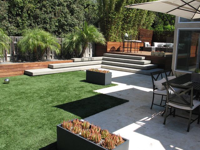 patio with raised steps and rectangular planters