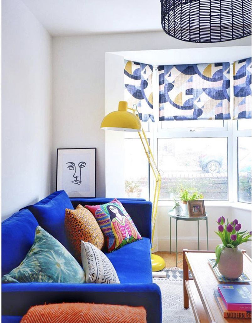 Bright blue couch in a living room