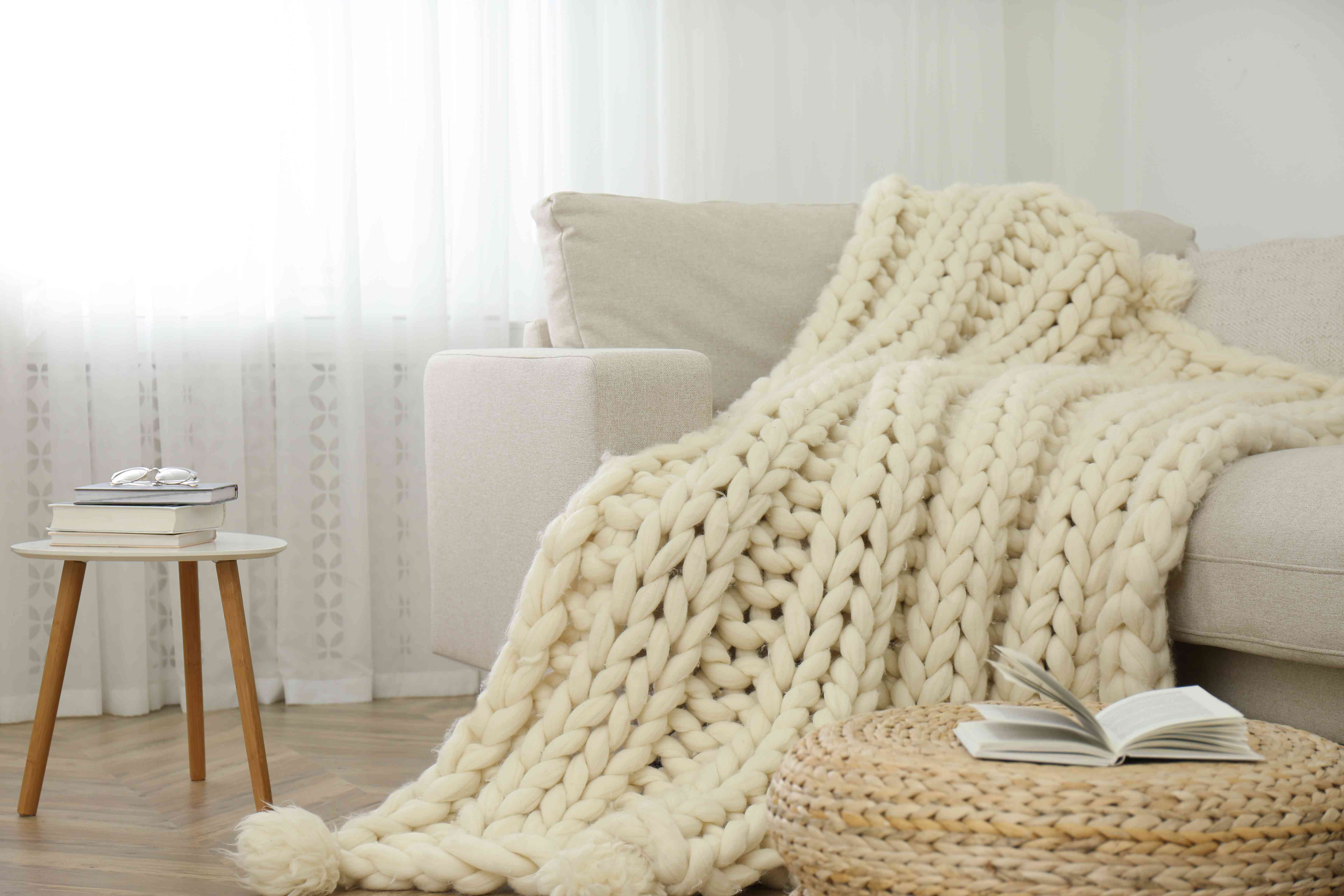A chunky throw blanket on a couch
