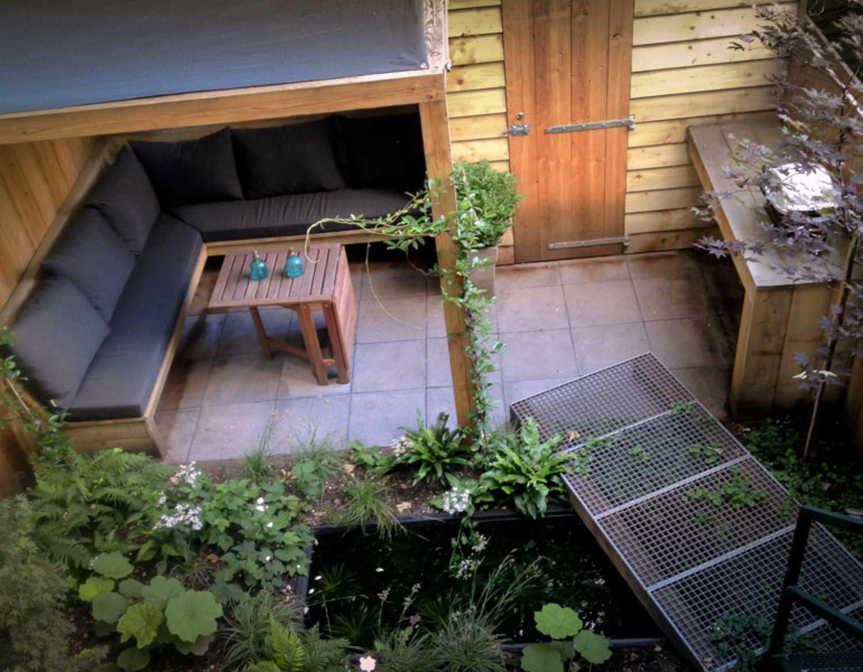 Tiny backyard pergola