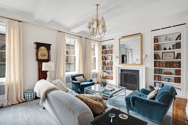 Formal living room with blue sofa and chairs