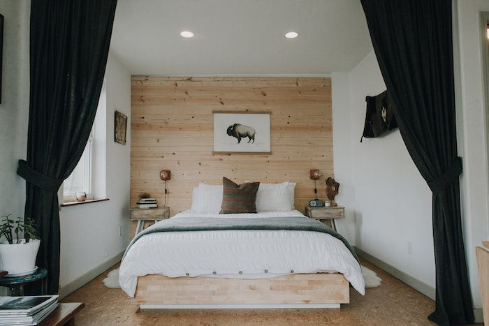 neutral bedroom with wooden accent wall, rustic