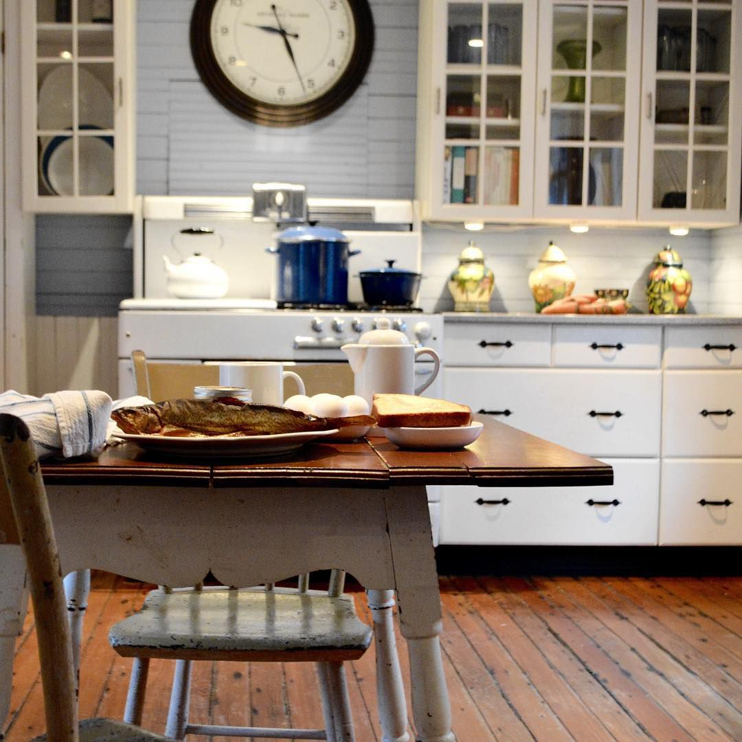Antique kitchen with a table in it