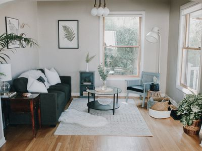 living room with dark green couch placed in the corner