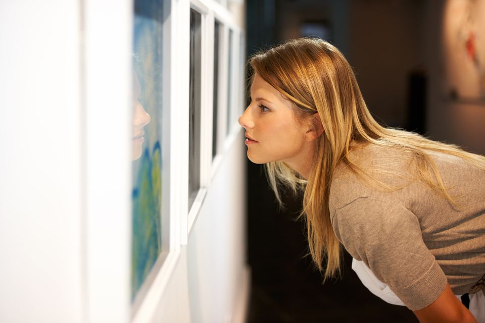 Young woman looking at art