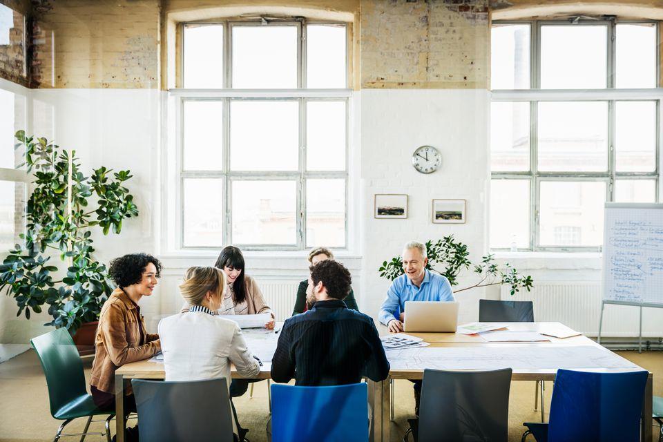 Meeting Between Board Members In Conference Room