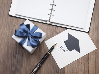 graduation card, notebook and gift