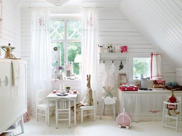 Rustic nursery playroom with whitewashed wood-paneled walls