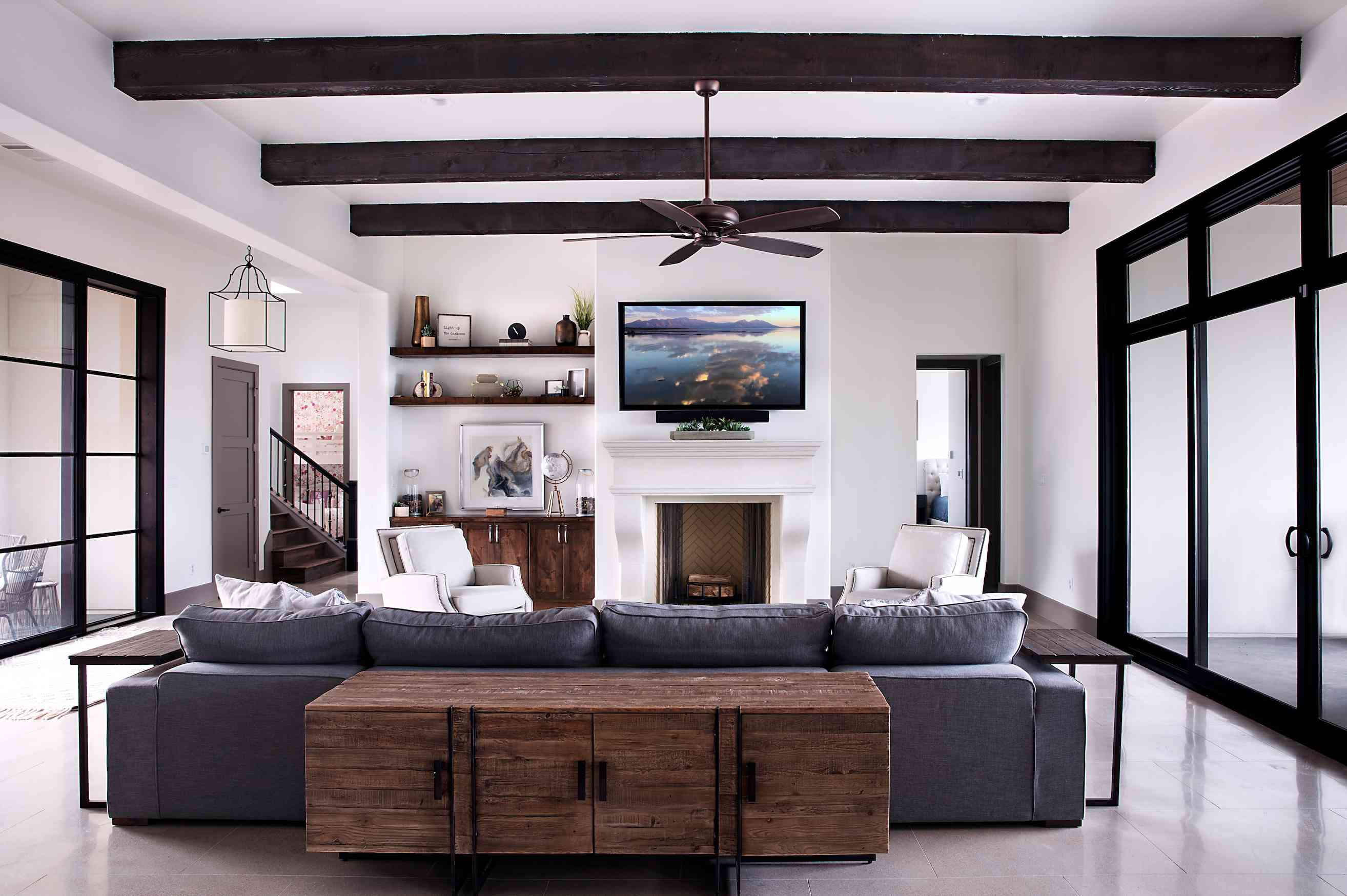 Living room by Etch Design Group