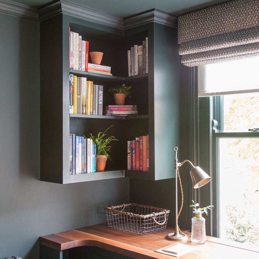 work area with custom fit corner bookshelves