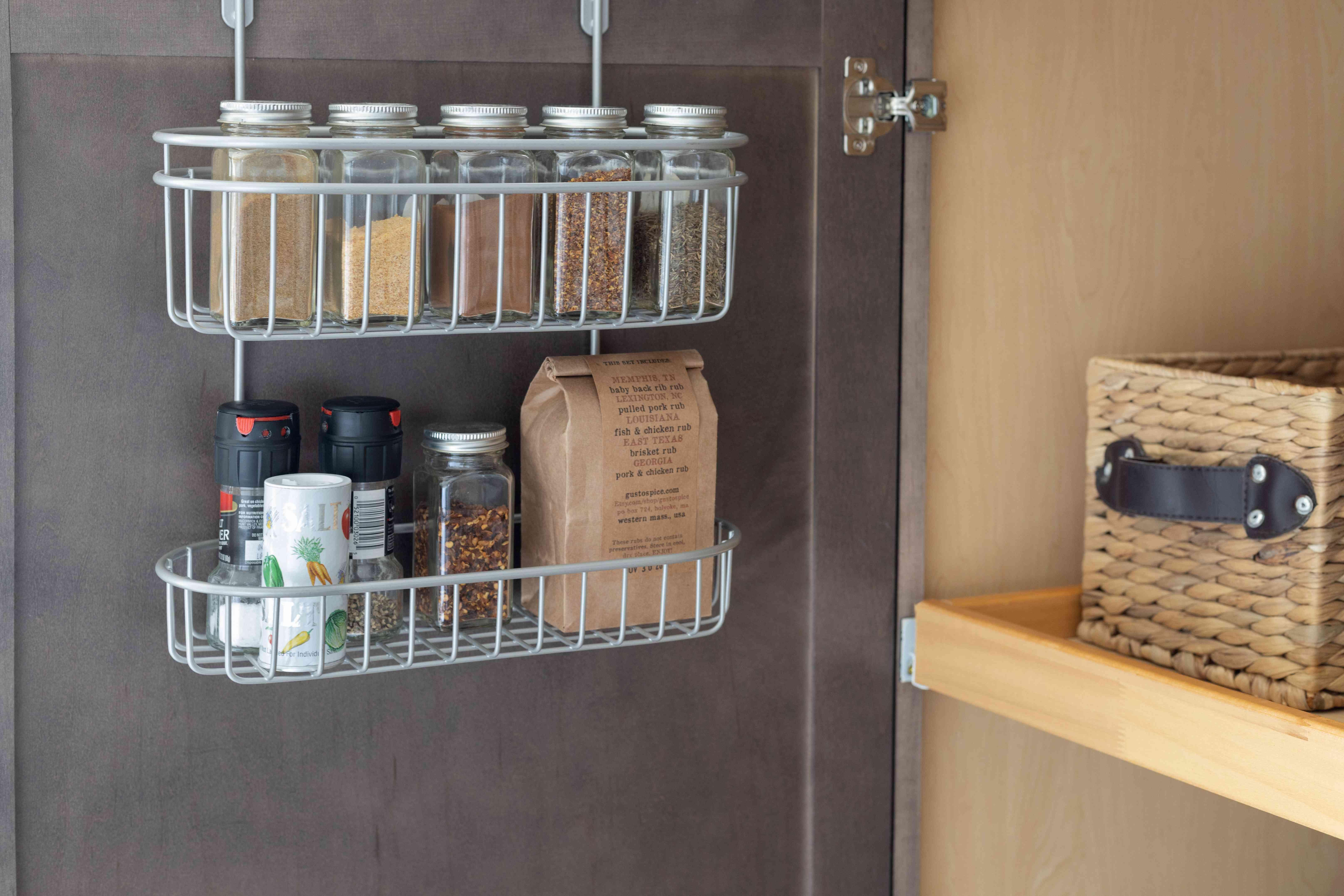 Metal shelf hanging inside pantry door