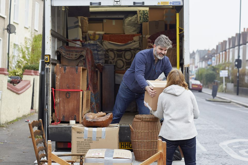 Man and Woman Loading Removal Van