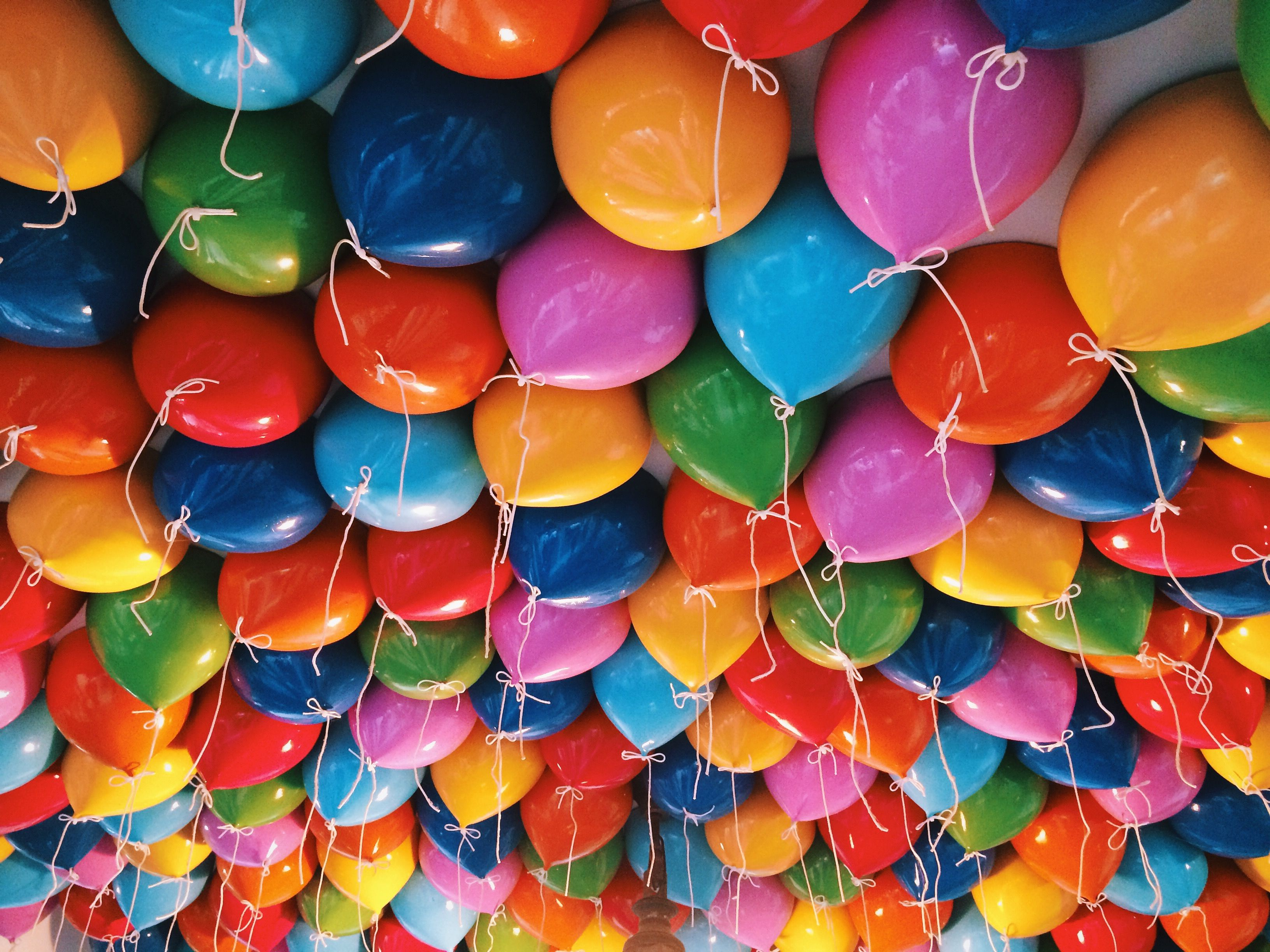 Colorful Helium Balloons Against Ceiling